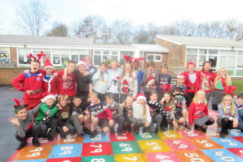 Group photo of St John's primary school wearing their Christmas jumper, December 2016